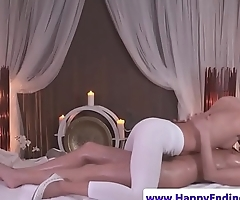 Lesbo masseuse fingers her clients wet pussy