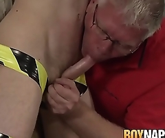 Restrained twink sucked off by mature master and milked