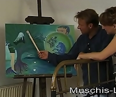 She bothers while painting and gets fucked