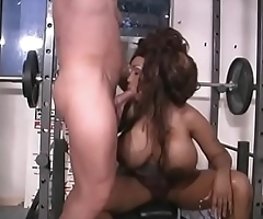 Black girl goes to the gym and sucks on some white cock