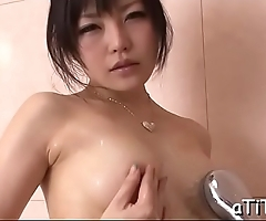 Sexy japanese with large hooters plays with a sex tool