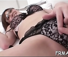Asian toys her twat in advance of taking on a cock with her throat
