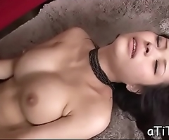 Voluptuous asian stimulates her cookie with a powerful toy