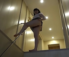 Anal masturbation with different sex toys to a bright orgasm, a brunette with a juicy ass in a short skirt has fun on the stairs.