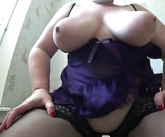 Busty milf in stockings jumps from above on dildo, her big butt shaking, big tits swing and jump.